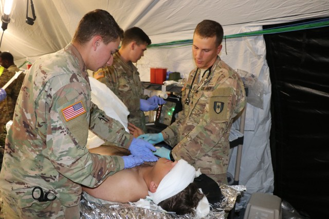 Soldiers from the 586th Field Hospital treat a simulated casualty in their new field hospital during a field exercise Oct. 16, 2018.  The training was the first time the unit was able to break out its new 148-bed field hospital platform since transitioning from the 86th Combat Support Hospital to the Army's new modular field hospital platform.