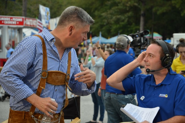 FORT BENNING, Ga. (Oct. 24, 2018) - Lt. Col. Alexander Sauer, left, German army liaison, talks with Jason Dennis, WTVM 9 anchor, at Oktoberfest at Uchee Creek Campground. U.S. Army Garrison Fort Benning's Directorate of Family and Morale, Welfare and Recreation (DFMWR) hosted an Oktoberfest Oct. 19 through 21 at Uchee Creek Campground in the Alabama part of the garrison. (U.S. Army photo by Bryan Gatchell, Maneuver Center of Excellence, Fort Benning Public Affairs)