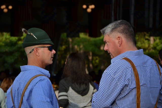 FORT BENNING, Ga. (Oct. 24, 2018) - Col. Clinton W. Cox, left, U.S. Army Garrison Fort Benning commander, and Lt. Col. Alexander Sauer, right, German army liaison, talk during Oktoberfest. USAG Fort Benning's Directorate of Family and Morale, Welfare and Recreation (DFMWR) hosted an Oktoberfest Oct. 19 through 21 at Uchee Creek Campground in the Alabama part of the garrison. (U.S. Army photo by Bryan Gatchell, Maneuver Center of Excellence, Fort Benning Public Affairs)