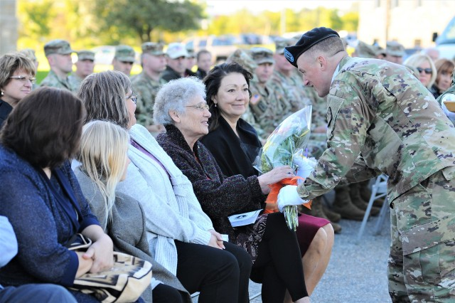 Ms. Barb Muchow, the mother of Col. Marty Muchow, was presented with flowers during her son's retirement ceremony while Col. Sandy Muchow looks on. The senior explosive ordnance disposal (EOD) officer for the 20th Chemical, Biological, Radiological, Nuclear, Explosives (CBRNE) Command, Col. Marty Muchow, was recognized for his 30 years of service to our nation during a retirement ceremony held in front of the former Ordnance Corps headquarters (1940 -- 2008) on Aberdeen Proving Ground, Oct. 18.