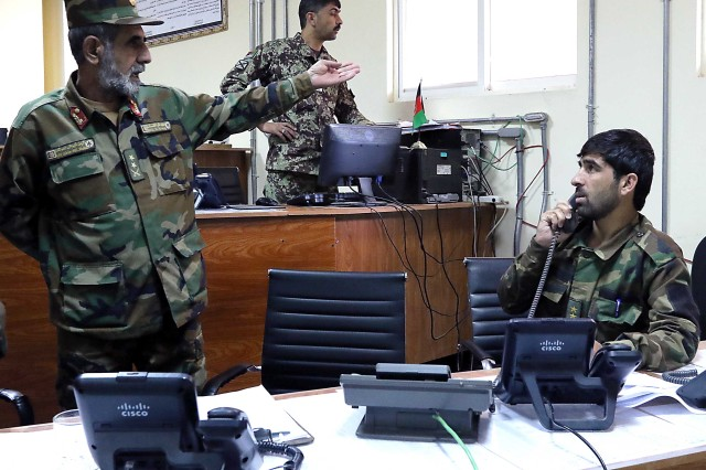 An Afghan lieutenant colonel (standing) makes a point in the Afghanistan National Army 203rd Corps' Joint Operations Center Oct. 10 at Forward Operating Base Thunder. (Photo by Jon Micheal Connor, Army Public Affairs)