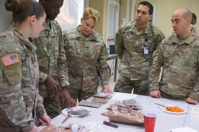 Col. Rebecca Porter, PHCE Commander, talks with Soldiers during the Joint Food Protection Training Summit.