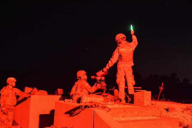U.S. Army Reserve Sgt. Gordon Massiah, Task Force Ultimate cadre, signals to the tower with a chemical luminescent stick at night-fire qualification during Operation Cold Steel II, hosted by U.S. Army Civil Affairs and Psychological Operations Command (Airborne), Aug. 7, 2018 at Joint Base McGuire-Dix-Lakehurst, N.J. The Army is slated to release the newest Enhanced Night Vision Goggle-Binocular to a select number of combat units sometime in fiscal year 2019.