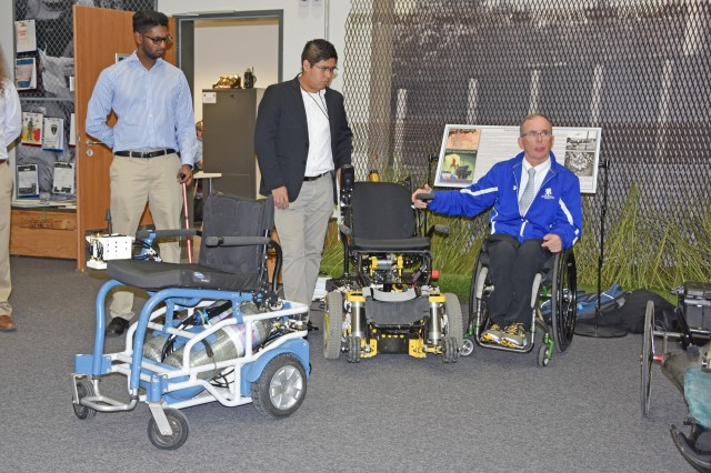 WIESBADEN, Germany -- Army veteran Dr. Rory Cooper shows off medical rehabilitation robotics technologies Oct. 1, 2018, at the Mission Command Center on Clay Kaserne. The yellow and black chair moves in all directions, as well as forward to help a user get out of the chair.