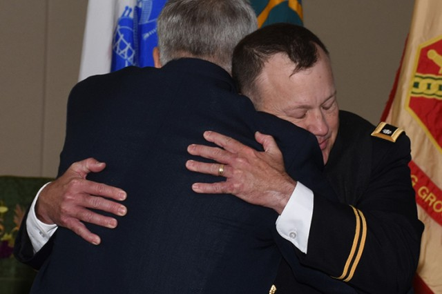 181001-A-BB276-008 Chaplain (Lt. Col.) James Lester, after swearing to the Oath of Office, hugs retired Army Chaplain (Col.) David Brown. He was sworn in during an Oct. 1, 2018 ceremony at Dugway Proving Ground, Utah. Brown and Chaplain Lester once served together in active duty and are good friends. Photo by Al Vogel, Dugway Proving Ground Public Affairs.