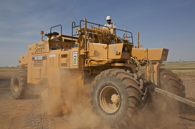 A U.S. Army Corps of Engineers, Tulsa District contractor operates a self-propelled RS-650 Reclaimer/Stabilizer to mix loose soil and material in preparation for constructing an assault landing zone runway on Altus Air Force Base, Okla., July 20, 2018. The reclaimer is also used for stabilizing subgrade material by mixing existing soil with water from a connected water truck.