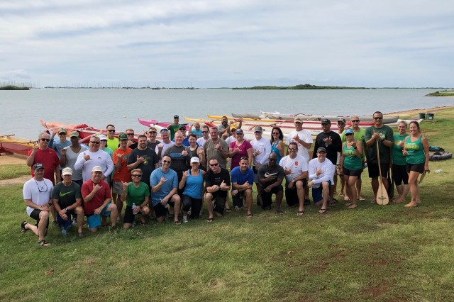 IMCOM-Pacific garrison commanders, their deputies and staff celebrate after participating in outrigger canoe races as part of a team-building exercise in Honolulu's Keehi Lagoon Park, Oct. 18.
