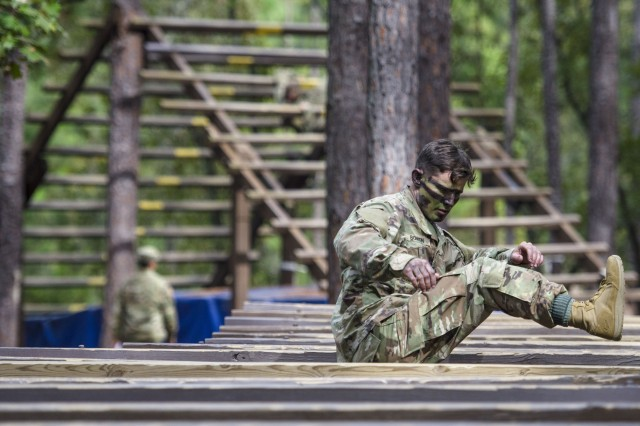 Staff Sgt. Dakota Bowen, 3rd Battalion, 39th Infantry Regiment, navigates the Hip-Hip obstacle as a fellow competitor works their way through the Weaver obstacle behind him during the Drill Sergeant/Non-commissioned Officer/Soldier of the year competition held on Fort Jackson, Oct 23 -27.