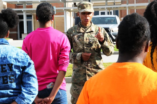 CW3 Docaser Bennett, WOCC TAC officer, instructs a group of JROTC cadets in what to do if a senior officer approaches a formation of Soldiers.