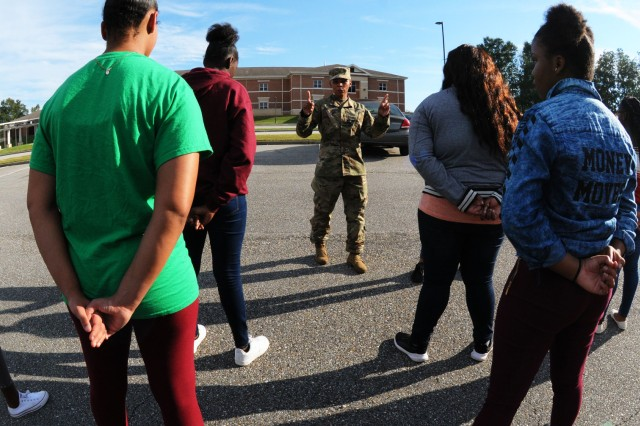 Bennett instructs a group of JROTC cadets on how the lead a formation of troops prior to a marching exercise.