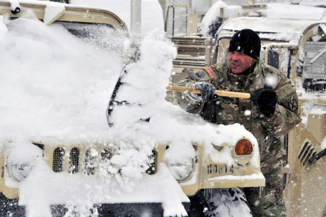 A 10th Mountain Division Sustainment Brigade Soldier shovels snow off a Humvee as part of motorpool maintenance at Fort Drum on Nov. 21, 2017. The Fort Drum Safety Office offers Soldiers, family members and Department of the Army employees with free winter driving and snow blower operation courses. (U.S. Army photo by Sgt. Liane Hatch)