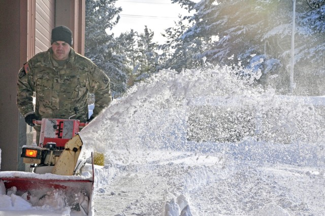 Sgt. Cecil West, 10th Mountain Division Sustainment Brigade, uses a snowblower to clear a path in the unit's motorpool at Fort Drum following a lake effect snow storm on Jan. 6, 2017. The storm resulted in several feet of snow, causing a delay on base as soldiers worked to clear their areas of operation. Fort Drum Soldiers, family members and Department of the Army civilians can register for free winter driving and snow blower operation courses through the Command Safety Office now through Dec. 11. (U.S. Army photo by Sgt. Liane Hatch)