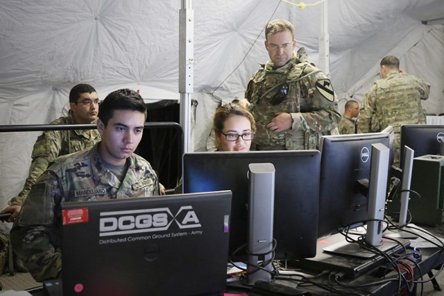 Soldiers from the 1st Cavalry Division Sustainment Brigade's combined operations and intelligence center process updates for current operations during Warfighter Exercise 18-05 at Fort Hood, Texas.