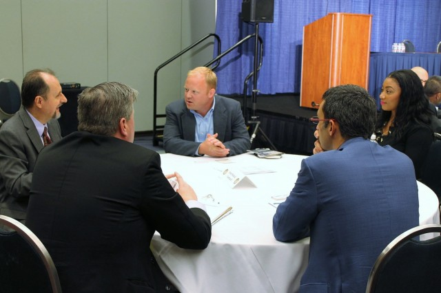 171010-A-IW334-001.jpg - Pete Hunter, Associate Director, Office of Small Business Programs for the Headquarters, U.S. Army Medical Command, meets with small business owners and representatives during the 2017 Association of the United States Army (AUSA) annual meeting on Oct. 10, 2017. Headquarters, Army Medical Command awarded approximately $917 million in contracts to small businesses in fiscal year 2018, meeting all five of the socioeconomic goals assigned by the Director of the Army's Small Business Program. (U.S. Army Image, MEDCOM/OTSG)
