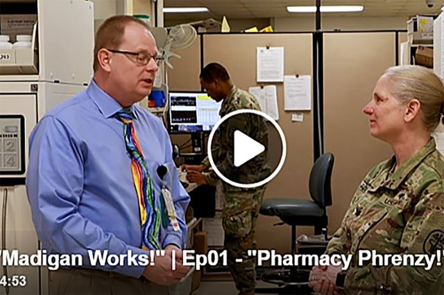 Dan Gardner, the chief of ambulatory (commonly called outpatient) pharmacy, Madigan Army Medical Center, walks Col. Suzanne Scott, the deputy commanding officer, Madigan, through the process of filling a prescription in the new Madigan Works video series premiere episode - Pharmacy Phrenzy.