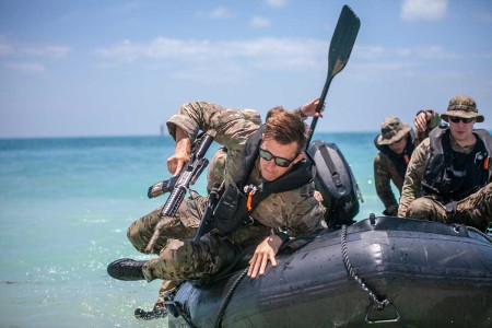 Soldiers attending the Special Forces Combat Diver Qualification Course at the U.S. Army John F. Kennedy Special Warfare Center practice skills needed to perform amphibious infiltration, June 7, 2018, Key West, Fla. Green Beret combat divers are assigned to U.S. Army Special Forces Operational Detachment - Alphas that specialize in maritime operations.