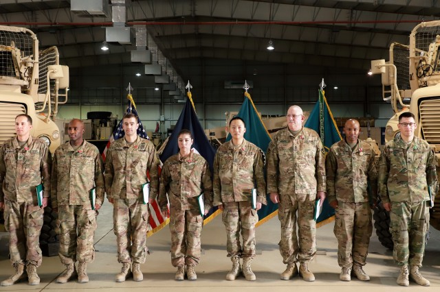 Members of the outgoing 20th Detachment receive their end of tour awards for their commitment and dedication to mission while serving in Afghanistan assigned to the 401st Army Field Support Battalion Afghanistan Battalion in Bagram Airfield, Afghanistan, Oct. 05.