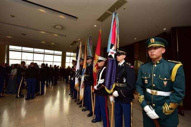 SUWON, Republic of Korea -- Members of the color guard hold the colors prior to the commencement of the 2nd Infantry Division's 101st Anniversary Ball at La Vie D'or Resort and Country Club Oct. 25. The color guard consisted of 2nd Infantry Division/ROK-U.S. Combined Division Soldiers, Republic of Korea Army Soldiers, and members of Marine Forces-Korea, representing and celebrating 101 proud years of combined and second to none history.