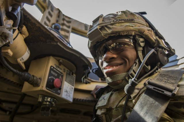 U.S. Army Pvt. Andre Chambers, a Soldier assigned to 348th Composite Supply Company, 194th Combat Sustainment Support Battalion, 2nd Sustainment Brigade, relaxes after completing a live-fire gunnery range near Warrior Base, South Korea, on Sept. 18, 2018. The Soldiers qualified on both day and night marksmanship training while operating a MRAP All-Terrain Vehicle (MATV). (U.S. Army photo by Spc. Adeline Witherspoon, 2nd Sustainment Brigade)