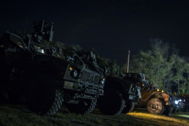 MRAP All-Terrain Vehicles, crewed by U.S. Army Soldiers assigned to 2nd Infantry Division, 2nd Sustainment Brigade, wait their turn to begin night-fire training operations near Warrior Base, South Korea, on Sept. 18, 2018. Vehicle crew evaluators (VCE) were present to offer feedback on crew duties, and to make sure each crew could be properly certified on their gunnery tables. (U.S. Army Photo by Spc. Adeline Witherspoon, 2nd Sustainment Brigade)