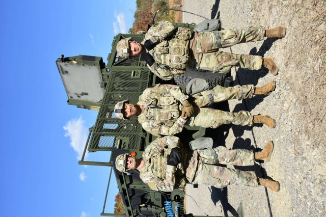 Staff Sgt. Gilberto Ramirez, Staff Sgt. Kevin Macadam and Staff Sgt. Ryan Ahern evaluate Spc. Natalia Nattress and Spc. Preston Pyle on Sentinel Radar Emplacement Table IV during a recent training event.