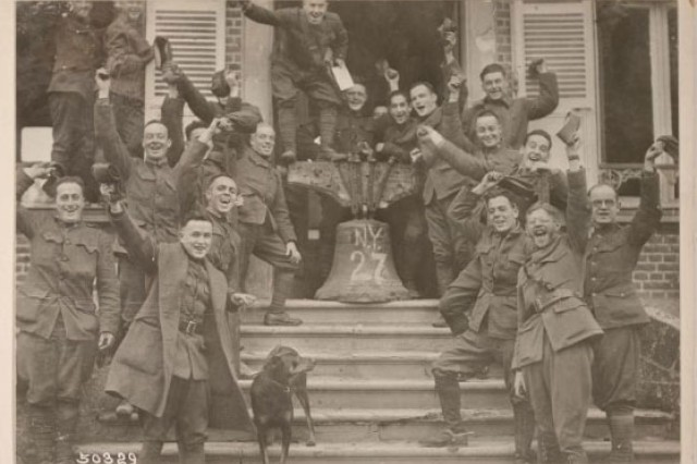 Soldiers of the New York National Guard's 27th Division celebrating the end of World War I following the Armistice on Nov. 11, 1918. According to Maj. Gen. John O'Ryan, the commander of the division, this photo and others like it were staged in the days following the signing of the document that ended combat in the World War by U.S. Army Signal Corps photographers.
