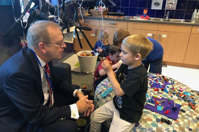 Jim Clark, Boys and Girls Clubs of America President and CEO, meets children Oct. 19, 2018, in Brussels. Clark visited the Child and Youth Services programs throughout the Benelux to see how he could enhance the opportunities for young people.