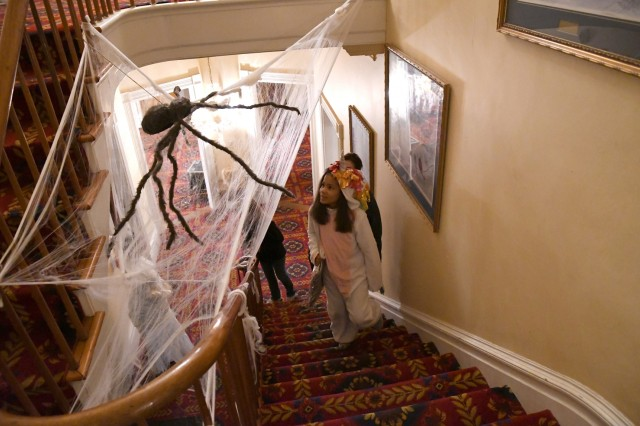 More than 100 Fort Drum community members attend the first Haunted LeRay Mansion Tour on Oct. 26 and discover the otherworldly history of the LeRay Historic District on post. (Photo by Mike Strasser, Fort Drum Garrison Public Affairs)