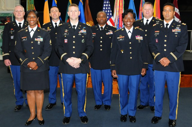 Eight Soldiers retired Oct. 26 at the quarterly retirement ceremony at the U.S. Army Aviation Museum. Front row: Staff Sgt. Miranda Jackson, CW3 Joshua Biretz, Command Sgt. Gloria Green and CW3 Christopher DeOliveira. Back row: CW4 David Hall, Lt. Col. Mitch Rosnick, CW4 Kenneth Thomas, Master Sgt. Joseph Christensen.