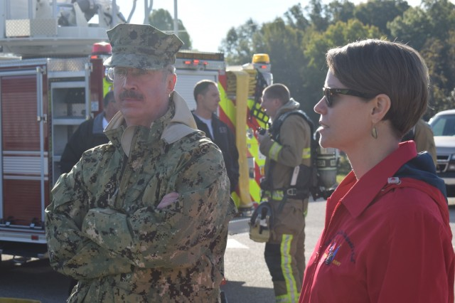 Readiness comes in all forms. Crane Army Ammunition Activity Emergency Manager Jessica Kirkendall confers with Naval Support Activity Crane Commanding Officer Cdr. Timothy Powers during a joint fire drill exercise at NSA Crane. Crane Army specializes in conventional munitions support for U.S. Army and Joint Force readiness, including storage, quality control, shipment preparation, distribution, production and demilitarization.