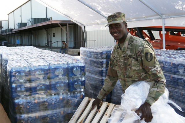 Pfc. Joseph Ante continuously improves his area during October 2018 at the Kingsland Community Center in Kingsland, Texas. The Guard gave out water, ice and supplies necessary for clean-up.