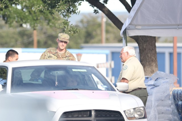 Texas National Guardsmen from the 372nd Combat Support, 36th Sustainment Brigade, set up a distribution point with local partners, October 2018 at the Kingsland Community Center in Kingsland, Texas. Guardsmen partnered with Salvation Army, American Red Cross, Texas A&M Forest Service and local first responders to give out water, ice and supplies to Texans in need following severe flooding.