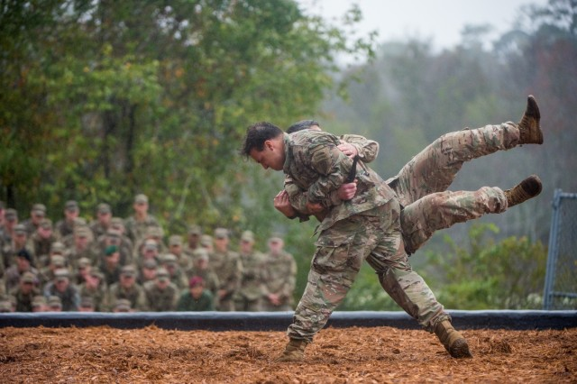 Two Soldiers with the Airborne and Ranger Training Brigade demonstrate hand-to-hand combat maneuvers during the Rangers In Action demonstration preceding a Ranger Course graduation, Oct. 26, 2018.