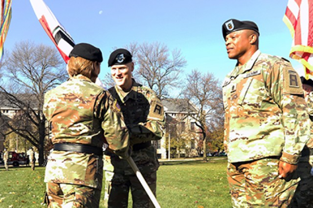 Lt. Gen. Thomas S. James Jr. receives the First Army flag from Lt. Gen. Laura Richardson, acting commanding general of U.S. Army Forces Command, during the First Army assumption of command ceremony on Oct. 29 at Rock Island  Arsenal, Ill.
