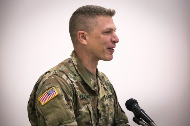 U.S. Army Capt. Domenico Lazzaro, a specialty branch recruiter with the New Jersey Army National Guard, addresses the audience during the National Disability Employment Awareness Month observance at Joint Force Headquarters located at Joint Base McGuire-Dix-Lakehurst, N.J., Oct. 18, 2018. On June 11, 2017, Lazzaro fell while navigating an obstacle course at Joint Base McGuire-Dix-Lakehurst and fractured his T8 vertebrae. The seven-hour surgery left him paraplegic. Lazzaro's goal is to be able to pass the Army physical fitness test and continue to serve in the Guard.