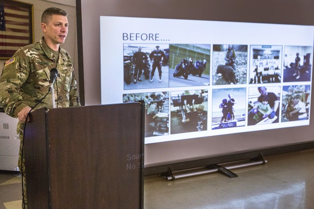 U.S. Army Capt. Domenico Lazzaro, a specialty branch recruiter with the New Jersey Army National Guard, shows the audience pictures of some of the activities he was involved in during the National Disability Employment Awareness Month observance at Joint Force Headquarters located at Joint Base McGuire-Dix-Lakehurst, N.J., Oct. 18, 2018. On June 11, 2017, Lazzaro fell while navigating an obstacle course at Joint Base McGuire-Dix-Lakehurst and fractured his T8 vertebrae. The seven-hour surgery left him paraplegic. Lazzaro's goal is to be able to pass the Army physical fitness test and continue to serve in the Guard.