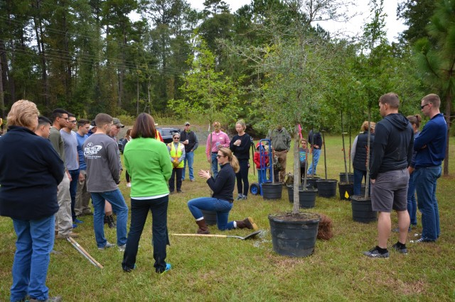 COLUMBUS, Ga. (Oct. 30, 2018) - Fort Benning Soldiers, their Family members and members of the community gathered Oct. 27 to plant trees on Fort Benning Road in Columbus, Georgia. Volunteers from the local environmental non-profit organization Trees Columbus and Soldiers from the Armor Basic Officer Leaders Course partnered to plant the first 20 out of 100 trees in celebration of Fort Benning's centennial over the weekend. (U.S. Army photo by Cristina Piosa, Maneuver Center of Excellence, Fort Benning Public Affairs)