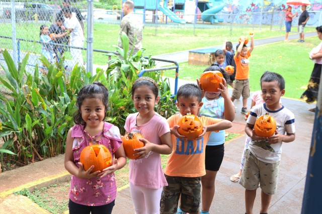 Students smile for picture and showcase their freshly carved pumpkins on October 25, 2018 at Linapuni Elementary School in Honolulu, Hawaii. Pumpkin carving at Linapuni Elementary School is an annual event between students and Soldiers.