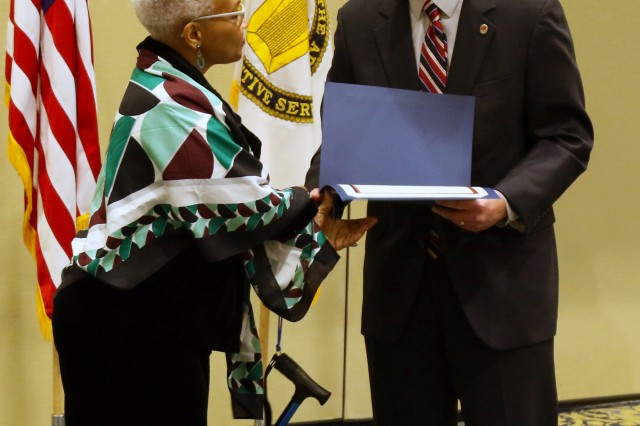 Mavis Muldrow, mother of Bret Muldrow, former intern for USASOC Workforce recruitment Program for College Students with Disabilities, accepts a certificate of appreciation, after her speech at the National Disability Employment Awareness conference, October 24, 2018. Presenting the award is Richard Holcomb, deputy to the commanding General.