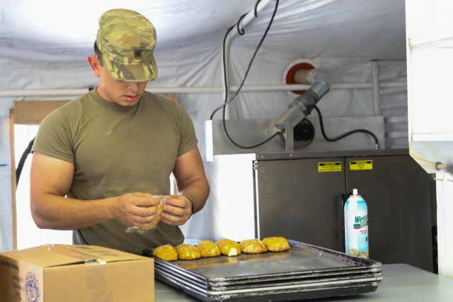 U.S. Army Sgt. Alejandro Rodriguez, a culinary specialist assigned to Company J, 1st Battalion, 41st Infantry Regiment, 2nd Infantry Brigade Combat Team, 4th Infantry Division, prepares dinner, Sept. 6, 2018, for the Soldiers in Tarin Kowt, Afghanistan. The Soldiers of Co. J make up the Tarin Kowt's Forward Logistics Element which provides food, fuel, water purification, supplies and maintenance to the base. (U.S. Army photo by Staff Sgt. Neysa Canfield)