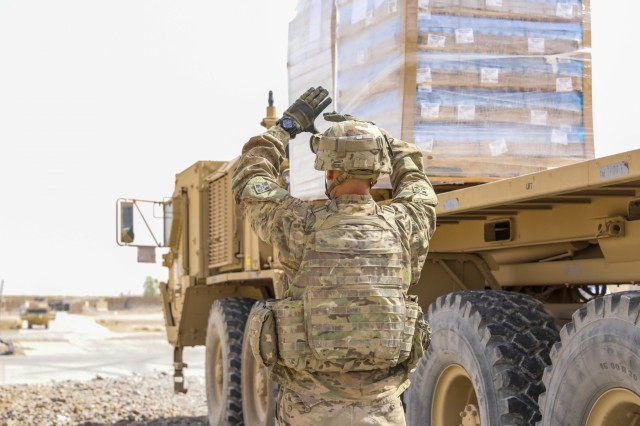 U.S. Army Spc. Gabriel Garzon, a motor transport operator assigned to Company J, 1st Battalion, 41st Infantry Regiment, 2nd Infantry Brigade Combat Team, 4th Infantry Division, ground guides a military vehicle, Sept. 6, 2018, in Tarin Kowt, Afghanistan. The Soldiers of Co. J make up the Tarin Kowt's Forward Logistics Element which provides food, fuel, water purification, supplies and maintenance support to the base. (U.S. Army photo by Staff Sgt. Neysa Canfield)