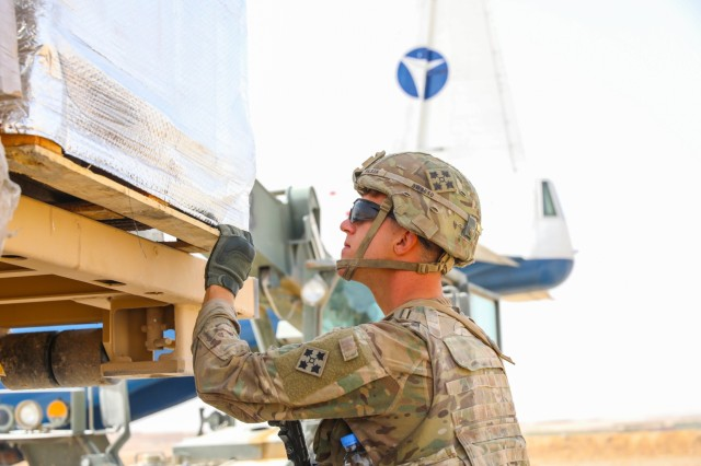 U.S. Army Spc. Michael Wilson, a motor transport operator assigned to Company J, 1st Battalion, 41st Infantry Regiment, 2nd Infantry Brigade Combat Team, 4th Infantry Division, checks supplies after loading them onto a military vehicle, Sept. 6, 2018, in Tarin Kowt, Afghanistan. The Soldiers of Co. J make up the Tarin Kowt's Forward Logistics Element which provides food, fuel, water purification, supplies and maintenance support to the base. (U.S. Army photo by Staff Sgt. Neysa Canfield)