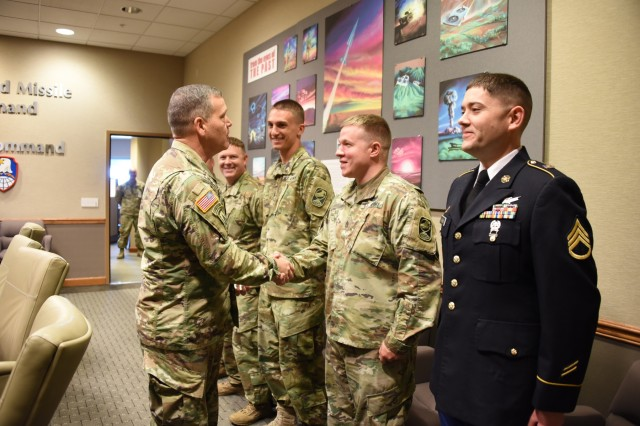 The five 100th Missile Defense Brigade (Ground-based Mid-course Defense) Soldiers who executed the intercept of a test intercontinental ballistic missile target May 30, 2017, are presented with coins of excellence by Lt. Gen. James Dickinson, left, commanding general, U.S. Army Space and Missile Defense Command/Army Forces Strategic Command, June 2, 2017, at SMDC headquarters in Colorado Springs, Colo.