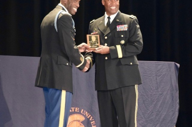 Brig. Gen. James S. Moore, 593rd Expeditionary Sustainment Command commanding general, receives his Virginia State University Alumni ROTC Hall of Fame induction award Oct. 19 from Lt. Col. Vashaun A. Wrice, the Professor of Military Science at VSU.