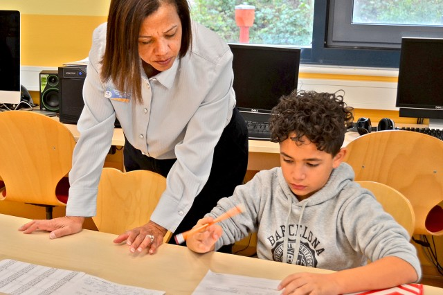 Wiesbaden Hainerberg School Age Center Director Katherine Vahrenkamp helps students with their homework during the special event.