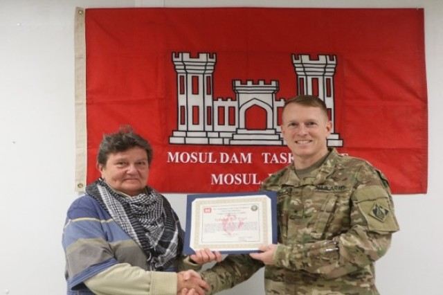 Jadwiga V. Figiel, office engineer, Mosul Dam Task Force (MTDF), receives her 30 day certificate from Brig. Gen. David C. Hill, Trans-Atlantic Division Commander, during his visit to Mosul, Iraq.