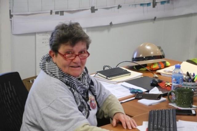 Jadwiga V. Figiel, office engineer, Mosul Dam Task Force (MTDF), working hard at her desk in Mosul, Iraq.