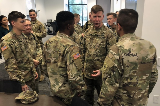 "Lt. Gen. Stephen G. Fogarty, commander of Army Cyber Command (ARCYBER) (third from right), talks with Soldiers participating in the ""Hack the Army"" bug bounty program during a visit to Augusta, Georgia for the launch of a partnership between ARCYBER partnership and the Defense Digital Service at the Georgia Cyber Center there  Oct. 25, 2018."