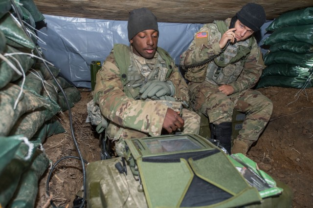 """A Soldier from the 39th Brigade Engineer Battalion """"Bullstrike,"""" and a Soldier from the 1st Battalion, 26th Infantry Regiment """"Blue Spaders,"""" 2nd Brigade Combat Team """"Strike,"""" operate as a team to defend their company defensive position using the Spider Increment 1A networked munition system, October 2018."""