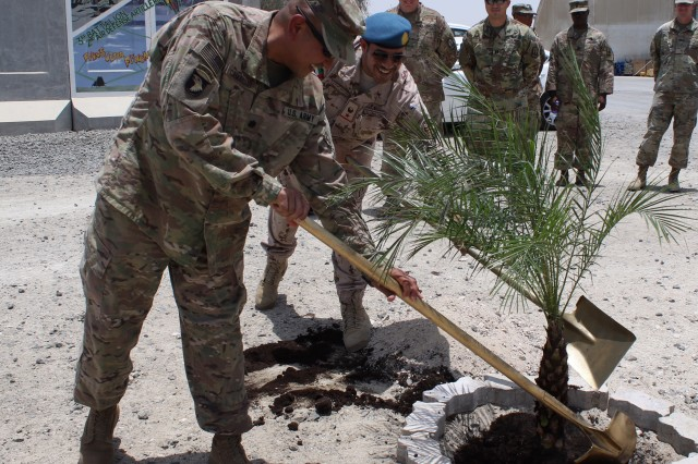 On a sunny Emirati day, Lts. Col. Pedro Camacho and Hamad Al Yammah plant a palm tree demonstrating their unity and the commitment between the nations.